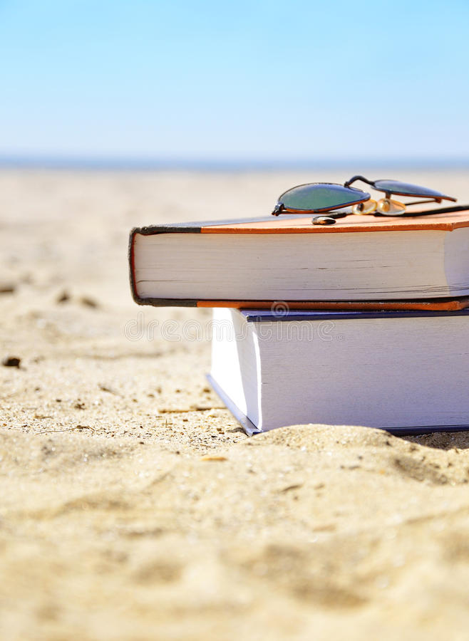 Download Vacation Beach With Books In Sand Royalty Free Stock Photos - Image: 25079388