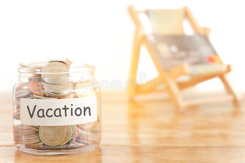 Vacation budget concept. Holidays money savings concept. Collecting money in the money jar for Vacation. Money jar with coins. royalty free stock photography