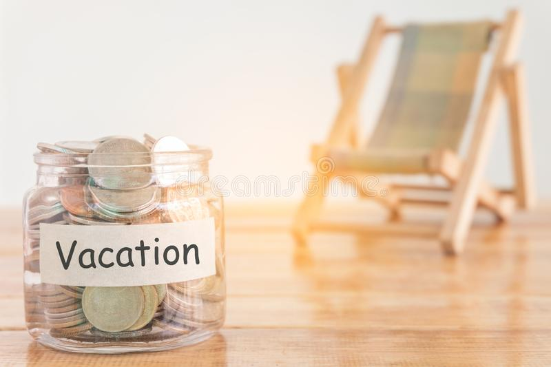 Vacation budget concept. Holidays money savings concept. Collecting money in the money jar for Vacation. Money jar with coins and. stock photos