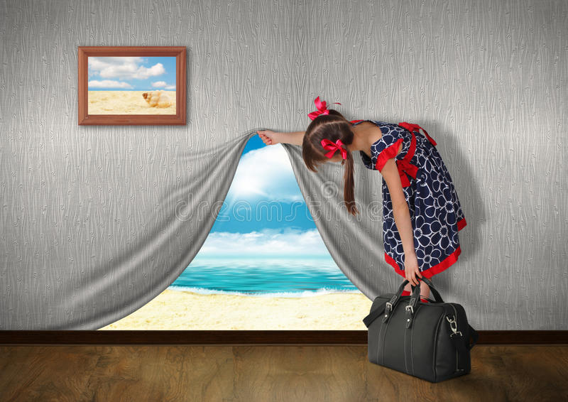 Vacation concept. Child look at sea behind the wall, vacation concept stock photography