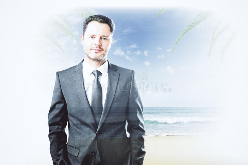 Vacation concept. Portrait of handsome caucasian man on beach background. Double exposure. Vacation concept royalty free stock photography
