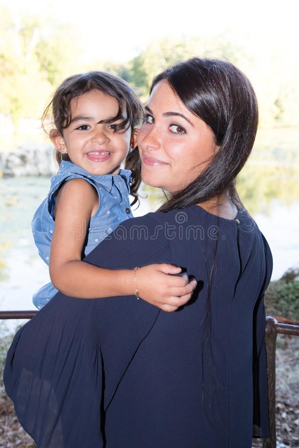 vacation day mother brunette with beautiful daughter in arms smile stock images