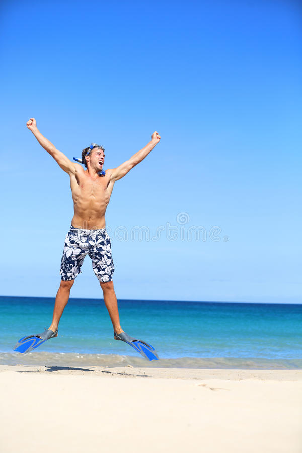 Vacation - Happy Beach Man Jumping With Snorkeling Royalty Free Stock Image