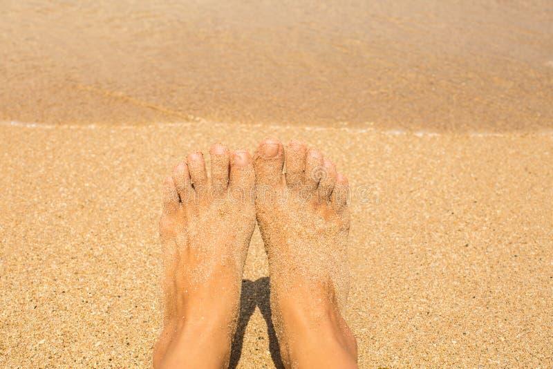 Vacation holidays. Woman feet closeup of girl relaxing on beach stock photos