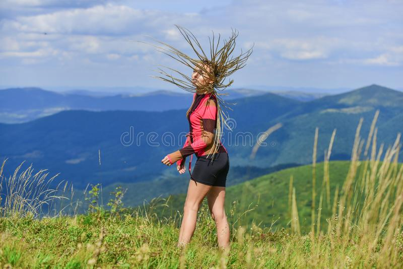 Vacation ideas. Healthy lifestyle. Sporty tourist hiker trekking. Summer tourism. Woman trekking clothes mountains royalty free stock image