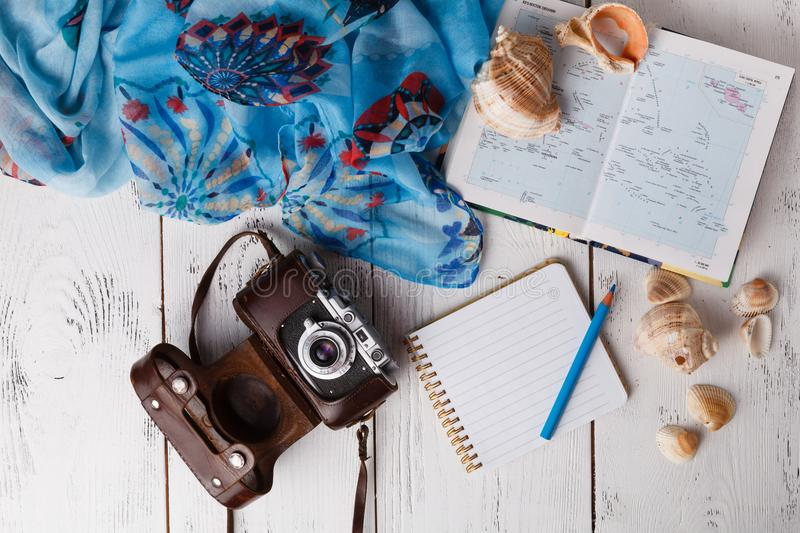 Vacation planning concept, flat lay with camera and map stock image