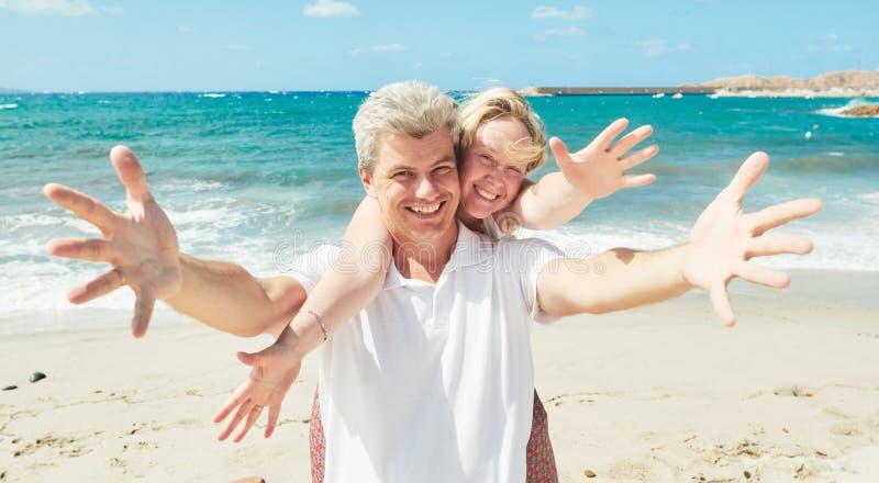 Vacation at sea. cheerful man and woman at seashore royalty free stock image