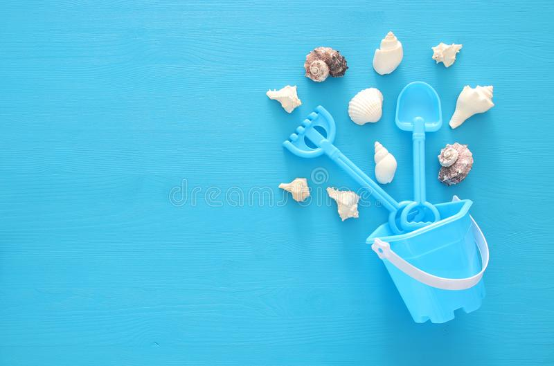 Vacation and summer image with sea life style objects and beach toys for kid. Vacation and summer image with sea life style objects and beach toys for kid stock images