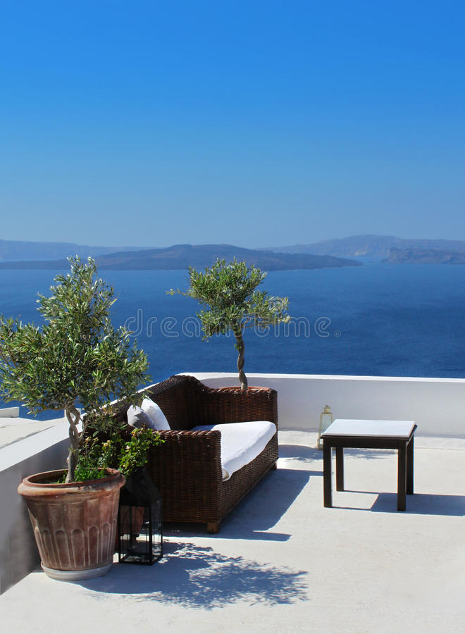 Vacation terrace above blue sea stock images