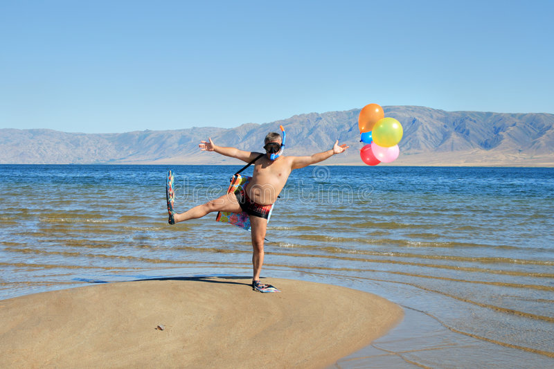 Vacation Time. Happy absurdly Infantile man at vacation on sunny beach stock photography
