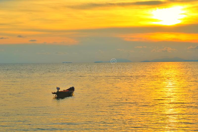 Vacation time concept, A boat going and parking in the sea with sunset time or golden time and cloud. royalty free stock photos