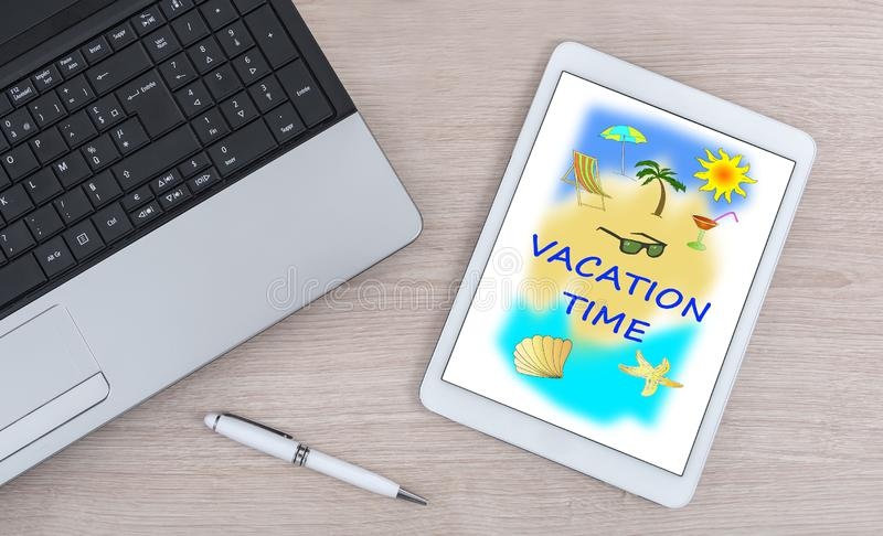 Vacation time concept on a digital tablet. Vacation time concept shown on a digital tablet royalty free stock photography