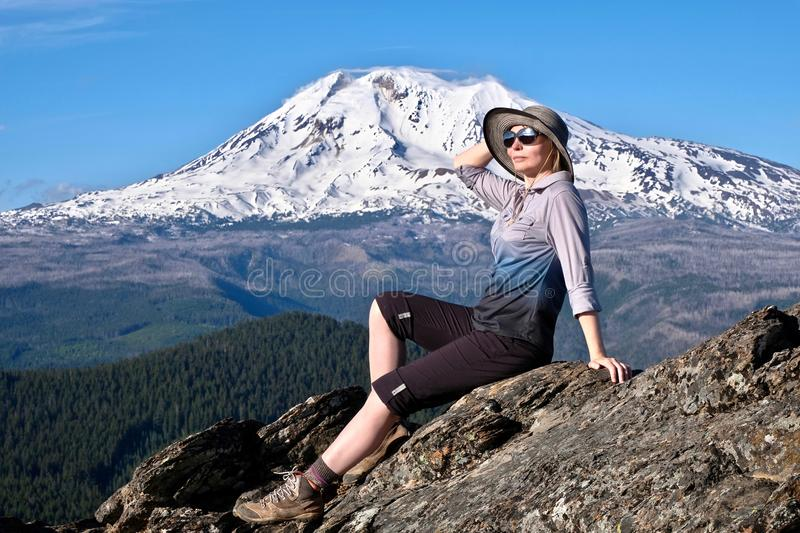 Vacation travel in Oregon and Washington. Middle age woman relaxing on mountain top by glacier on Mount Adams. Portland. Oregon. United States of America royalty free stock images