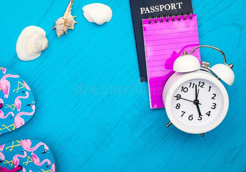 Vacation and Travel still life concept in bright colors and blue board, flat lay in vintage tones. Warm weather beach resort vacation holiday objects royalty free stock image