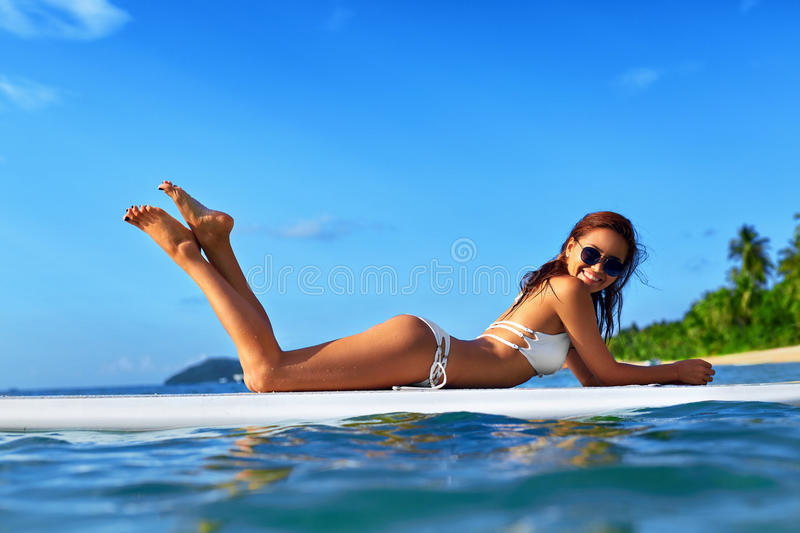 Vacation Travel. Summer Relax. Healthy Woman In Water. Recreational Sports. royalty free stock images