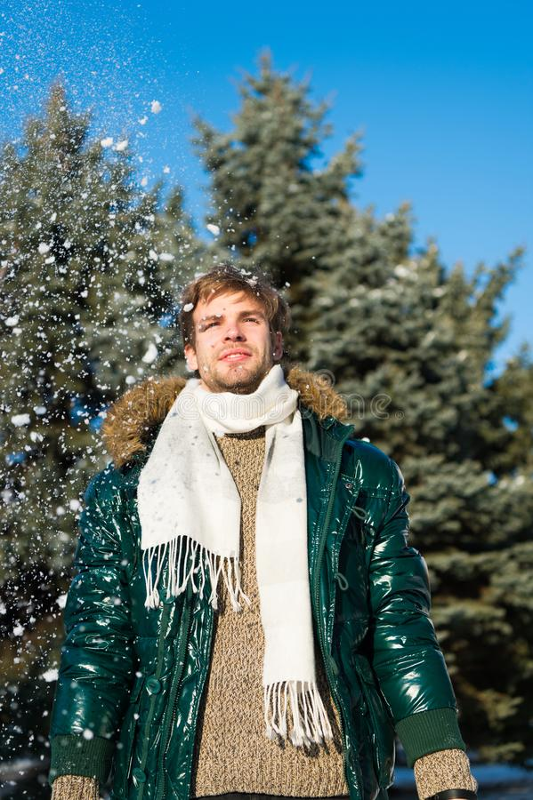 Vacation and traveling in winter. Snowy weather. Trendy winter coat. Man. It is cold outside. Forest in snow. Fresh air stock photography