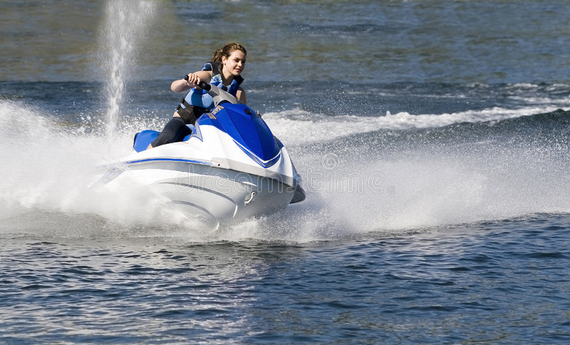 Vacation watersports. Action photo of woman on seado royalty free stock image