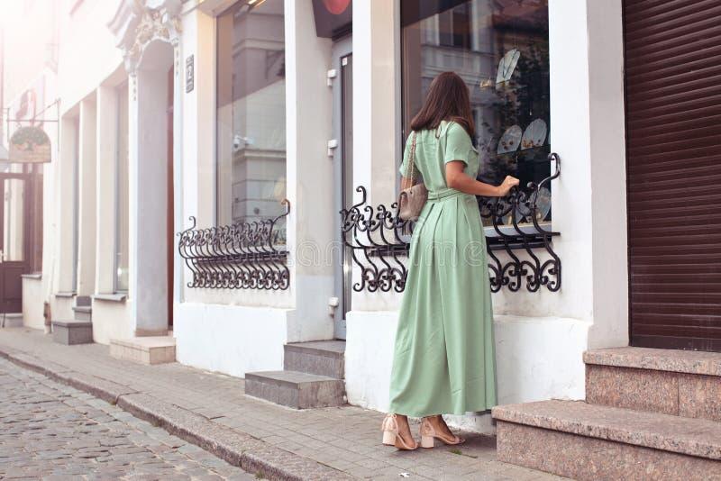 Vacation woman looking at window shop. royalty free stock image