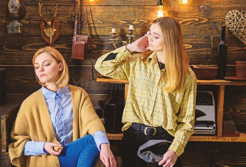 Vacation in woods concept. Girls on calm faces enjoy warm atmosphere while having rest. Girls enjoy vacation. Friends or. Sisters spend pleasant evening in royalty free stock photography