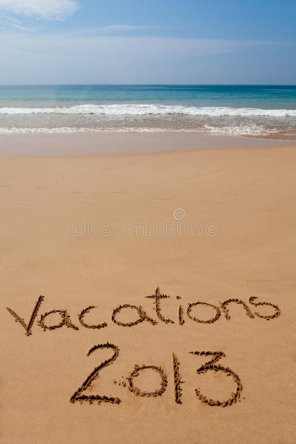 Vacations 2013 Written In Sand On Tropical Beach Stock ...