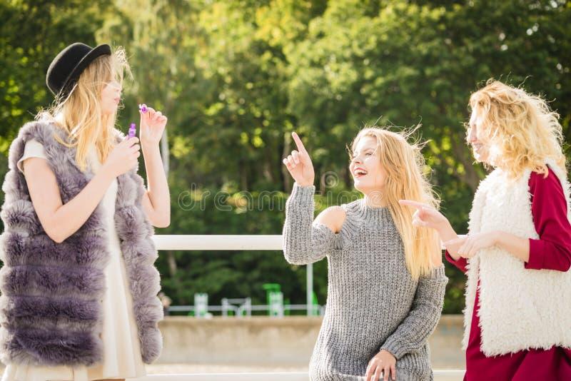 Women friends blowing soap bubbles stock photos