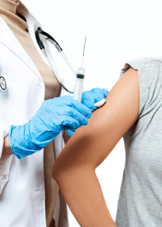 Vaccination. Doctor injecting flu vaccine to patient`s arm. Doctor making women an injection stock images