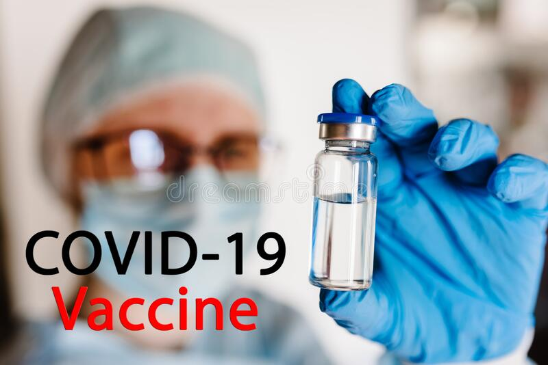 Vaccine Covid-19 text. Doctor, nurse, scientist hand hold vaccine for the disease Coronavirus. Use for prevention, immunization stock images
