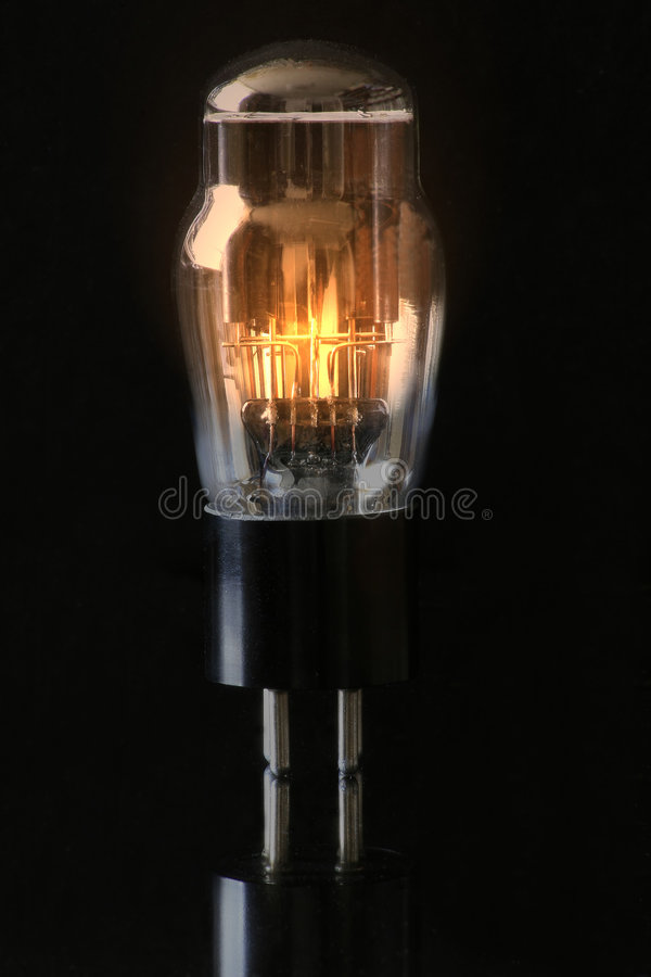 Vaccum Tube. A glowing vintage vaccum tube once used in television and radios, now obselete royalty free stock photos