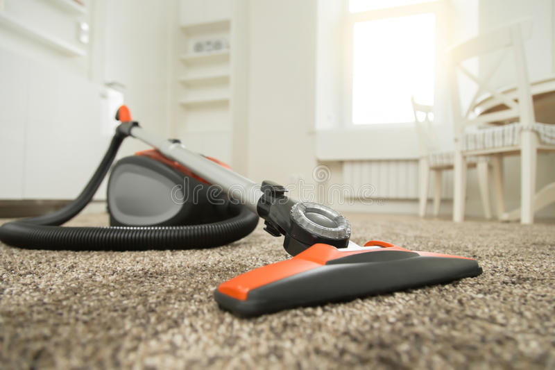 Vacuum cleaner on the carpet royalty free stock photography