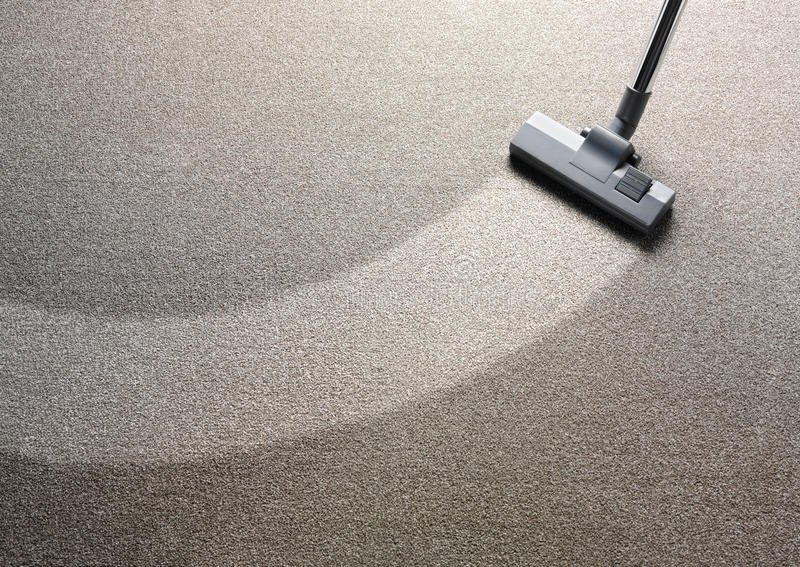 Vacuum Cleaner On A Carpet Stock Photo