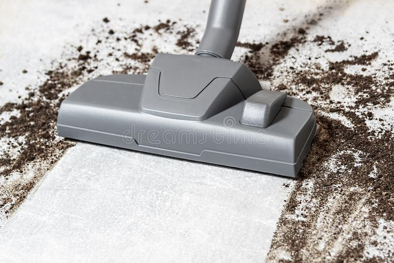 Vacuum cleaner. Carpet hoover. Cleaning. Dirty floor royalty free stock photo