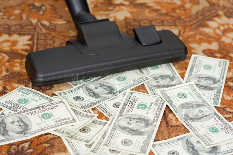 Vacuum cleaner and money royalty free stock photo