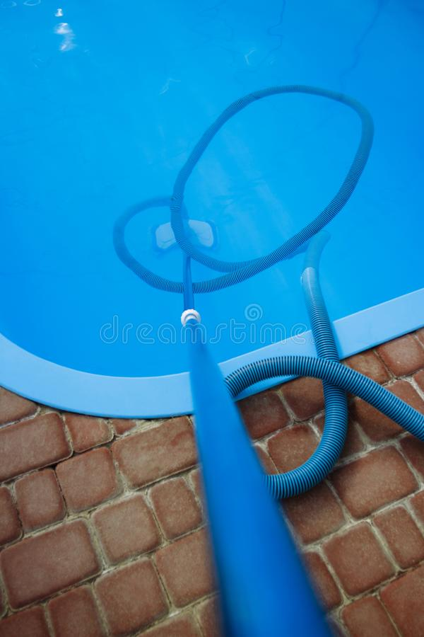 Vacuum cleaner for the pool, clean up and care for the bottom of the pool. collect, absorb garbage and dirt stock photo