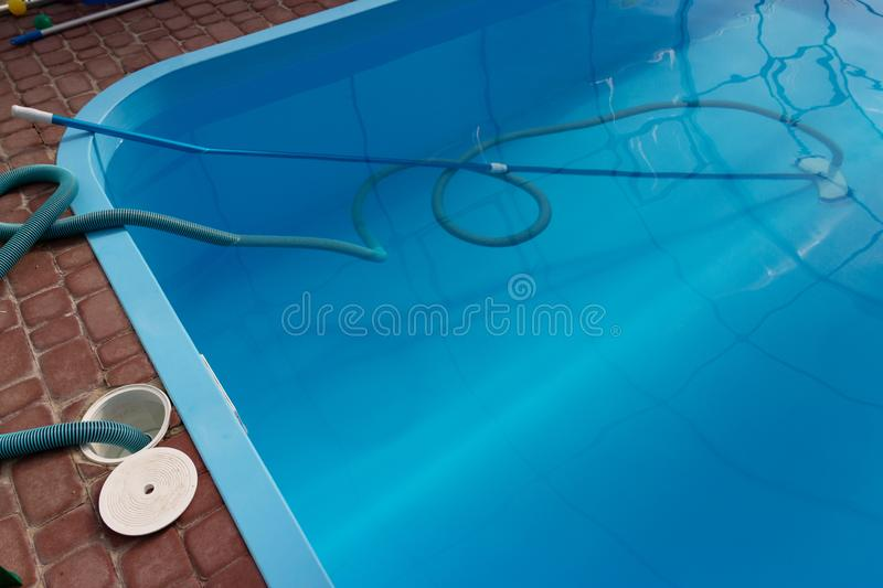 Vacuum cleaner for the pool, clean up and care for the bottom of the pool. collect, absorb garbage and dirt royalty free stock image