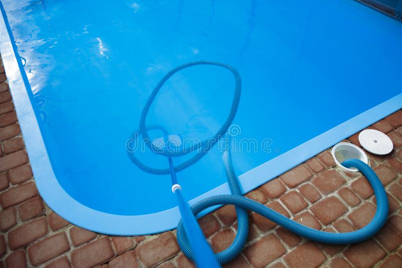 Vacuum cleaner for the pool, clean up and care for the bottom of the pool. collect, absorb garbage and dirt stock images
