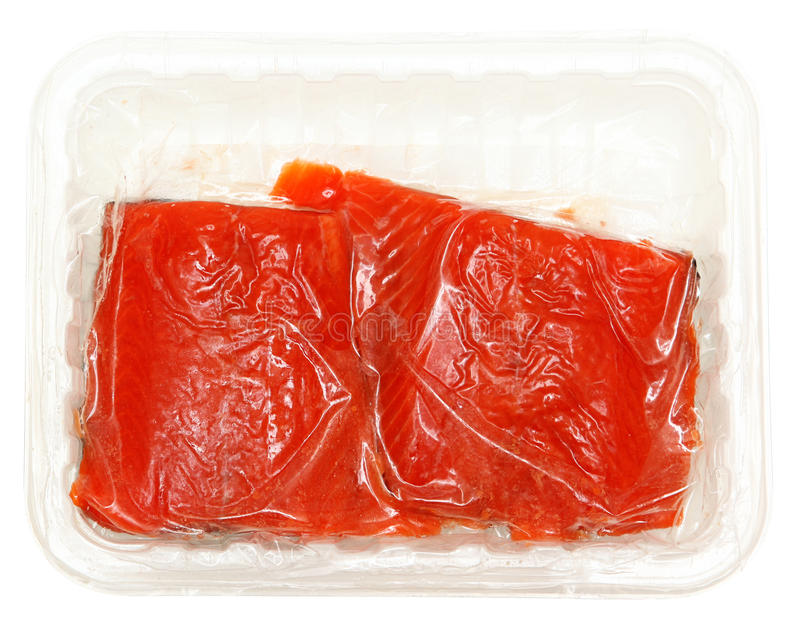 Vacuum Packed Raw Salmon. In plastic container over white isolated royalty free stock photos