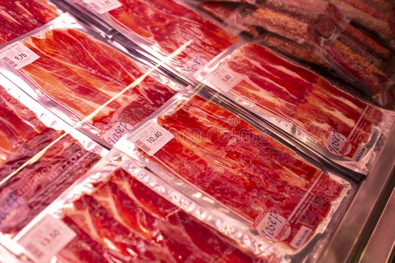 Vacuum-packed red Iberian jamon, spanish ham, in plastic package on the famous market in Barcelona, Catalonia, Spain. 30 royalty free stock images