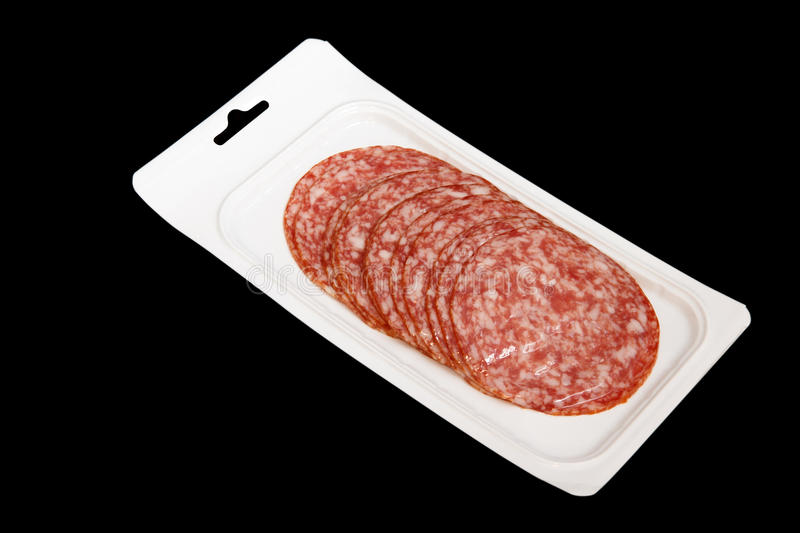 Vacuum-packed sliced salami royalty free stock photos