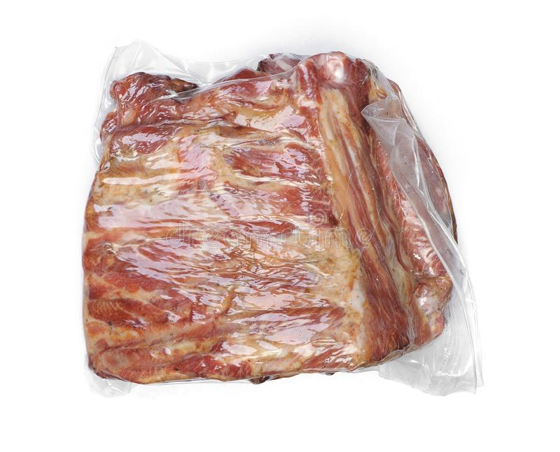 Vacuum packed smoked pork ribs. Meat isolated on white background stock images