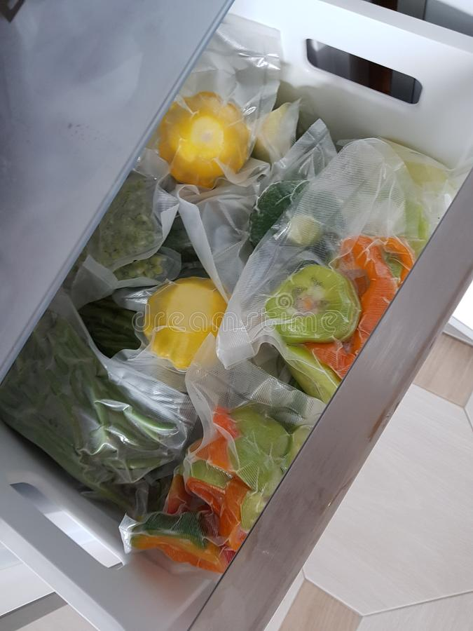 Vacuum packing of fresh vegetables. For the winter. Freezer. Home royalty free stock images