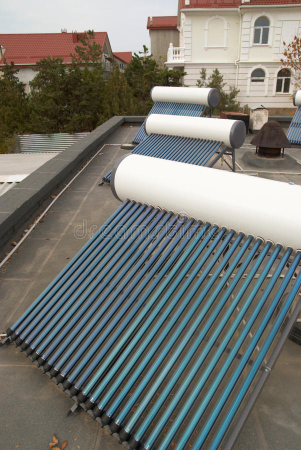 Vacuum solar water heating system. On the house roof royalty free stock image
