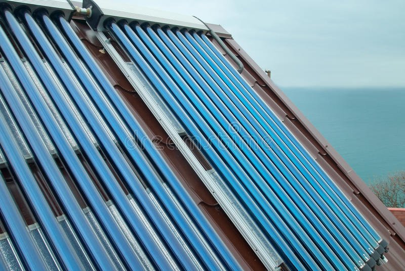 Vacuum solar water heating system. On the house roof royalty free stock photo