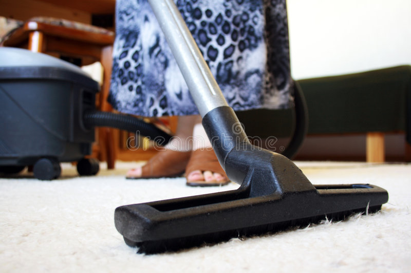 Vacuuming. Woman cleaning house with vacuum cleaner