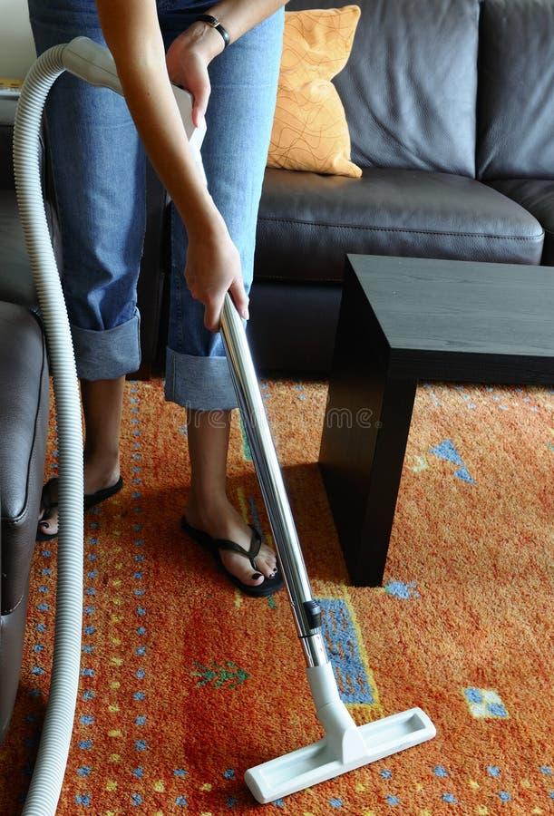 Vacuuming a carpet royalty free stock images