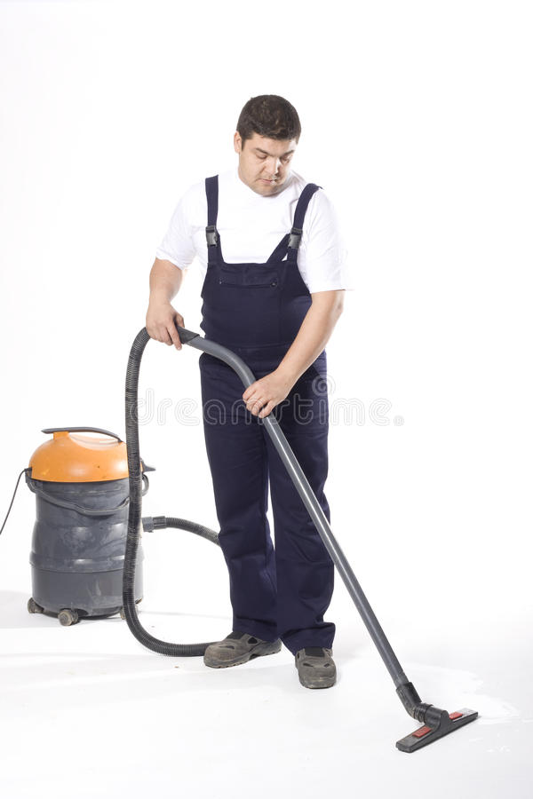 Vacuuming floor with machine stock photography