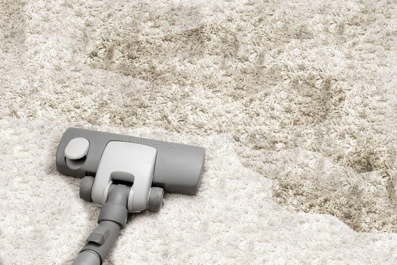 Vacuuming. Very dirty white carpet stock image