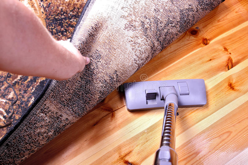 Vacuuming. Wooden flor in house royalty free stock images