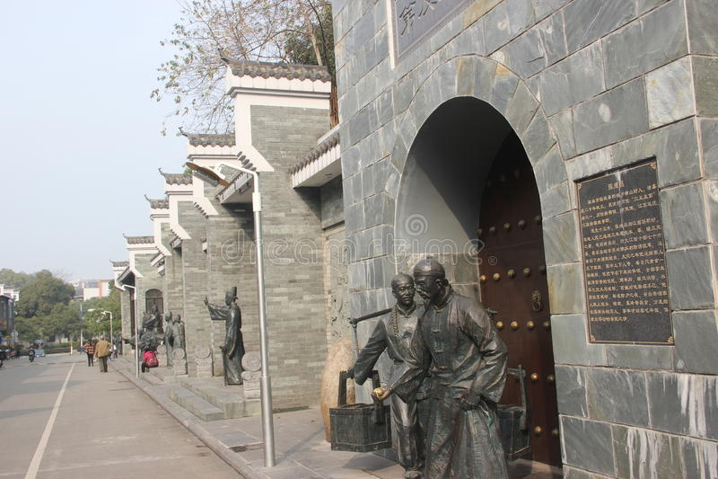 Vada alle statue del bronzo del commerciante del mercato in Qing Dynasty fotografia stock libera da diritti