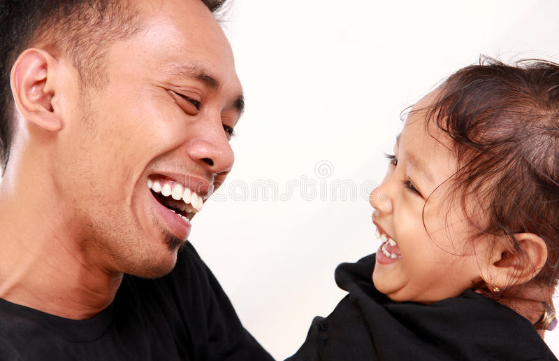 Vader en dochter gelukkig ogenblik stock afbeelding