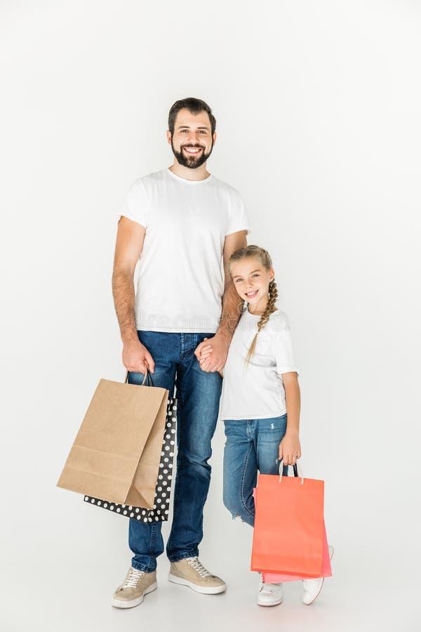 Vader en dochter met het winkelen zakken royalty-vrije stock foto's